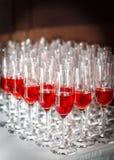 Vino, champán por el vidrio Imagen de archivo