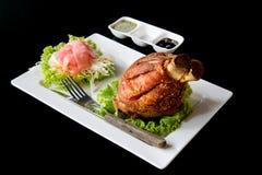 Vino del Reno tedesco della carne di maiale con salsa Immagini Stock