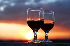 Vino en puesta del sol Fotografía de archivo