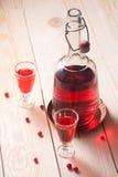 Vino rojo de bayas o del licor Imagenes de archivo