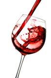 Vino rojo en un vidrio Imágenes de archivo libres de regalías