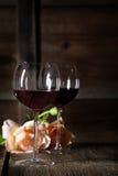 Vino rojo en vidrios Imágenes de archivo libres de regalías
