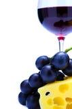 Vino rojo, queso y uvas Fotografía de archivo