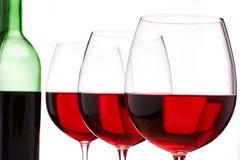 Vino rojo y botella Fotografía de archivo