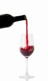 Vino rojo y una botella Foto de archivo