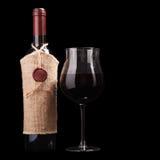 Vino rosso isolato sul nero Fotografia Stock Libera da Diritti
