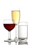 Vino rosso, succo di mele ed acqua minerale Fotografia Stock Libera da Diritti