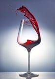 Vino rosso in un vetro Fotografia Stock