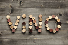 VINO. Written with corks on wooden table Stock Images