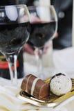Vino y chocolate Fotografía de archivo