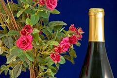 Vino y rosas Fotografía de archivo