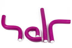Vinous curlers. Vinous flexible curlers make the word hair Royalty Free Stock Photography