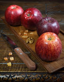 Vinous Gala apples on an old wooden surface Royalty Free Stock Image