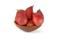Vinous pears in the bowl isolated on white. Vinous pears in the wood bowl isolated on white background Royalty Free Stock Image