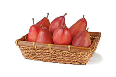 Vinous pears in wicker basket  on white. Vinous tasty pears in wicker basket  on white background Stock Image