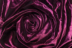 Vinous silk velvet. Vinous silk velvet fabric twisted in form of the rose Stock Image