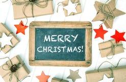 Vintag envuelto en papel de la pizarra de la decoración de la Navidad de los regalos del arte Fotografía de archivo libre de regalías