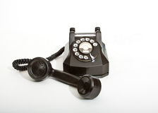 Vintage 1940 black rotary telephone. With reciever off the hook stock image
