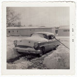 Vintage 1953 Buick Photograph. Vintage photograph of a 1953 Buick covered with snow. Black and white image printed in 1955 with scalloped edge boarder typical of Royalty Free Stock Image