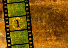 Vintage 35 mm movie film reel. Vintage 35 mm film reel, colorful background with grunge textured film frames and a number one in countdown Stock Photos