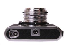 Vintage 35mm camera. Vintage 35mm film rangefinder camera – bottom view - isolated on white royalty free stock image