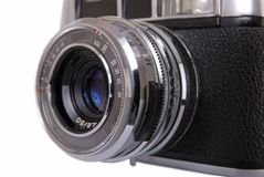 Vintage 35mm camera. Vintage 35mm film rangefinder camera – lens view - isolated on white royalty free stock images