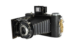 Vintage 35mm Camera with Clipping Path. This is a vintage 35 mm camera with an improvised strap, old style bellows construction and flip up viewfinder. Isolated Stock Photo