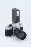 Vintage 35mm film camera with flash. Vintage 35mm film camera with electronic flash on it Royalty Free Stock Images