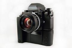 Vintage 35MM flim SLR camera. A 1980s vintage Single Lens Reflex 35MM film Camera with motor drive and 50MM lens stock images