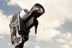 Vintage 8mm camera isolated on white Stock Photos