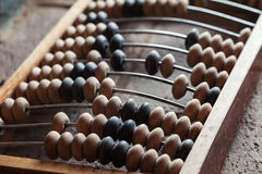 Vintage abacus lay on stone table. Close up photo with selective focus Royalty Free Stock Image