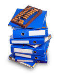 Vintage abacus on stack of blue folders Royalty Free Stock Images