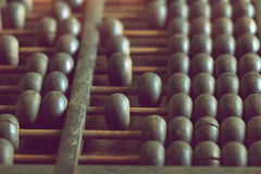 Vintage abacus on wooden background Royalty Free Stock Photo