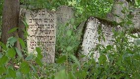 Vintage abandoned jewish cemetery. Vintage abandoned jewish cemetery. Tombstone with inscriptions in Yiddish.
