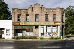 Vintage, Abandoned Pharmacy with Bluff Brown Brick and Green Porcelain Tiles Stock Photo
