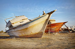 Vintage Abandoned Ships. Abandoned ships out of service on beach.  The Egyptian coast Royalty Free Stock Image