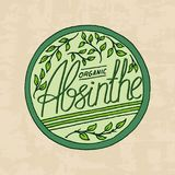 Vintage absinthe label badge. Strong Alcohol logo with calligraphic element. Frame for poster banner. Emblem sticker. Hand drawn engraved lettering for t-shirt royalty free illustration