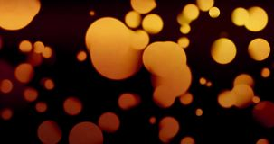 Vintage abstract circular yellow gradient glitter bokeh flowing on black background, congratulation greeting  party happy stock video footage