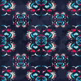 Vintage abstract colored flowers on a blue background seamless pattern grunge texture Stock Photo