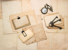 Vintage accessories, old postcards and papers Stock Photos