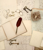 Vintage accessories, open book, old letters and documents retro Stock Images