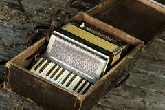 Vintage accordion. Beautiful vintage accordion  in old case Royalty Free Stock Photo