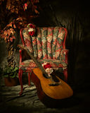 Vintage Acoustic Guitar Leaning Against Antique Chair Royalty Free Stock Images