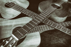 Vintage Acoustic Guitars Crossed. Three acoustic guitars with their necks crossed Stock Photography