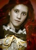 Vintage adolescente, joven con el pelo rojo largo Fotografía de archivo libre de regalías