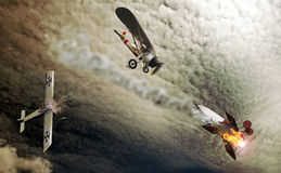 Vintage aerial fight. Three vintage planes from the begining of the 20th century, fighting in the sky Stock Image
