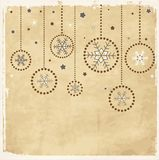 Vintage aged card with Christmas balls. Snowflakes Royalty Free Stock Photography