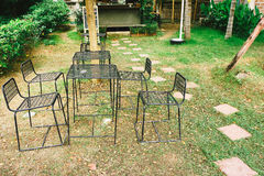 Vintage Aged metallic chair situated in garden. Forged iron park Royalty Free Stock Photos