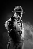 Vintage agent pointing a gun Stock Photo