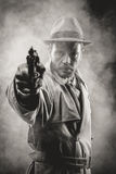 Vintage agent pointing a gun Royalty Free Stock Images